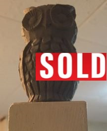 Owl with sold sign