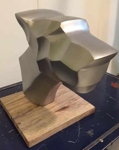 silver-coloured metal dog head sculpture