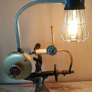 One-of-a-kind lamp with vintage features and a neck that moves. Solid base is an antique meat grinder.