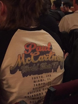 the back of a young girl in a seat in front of me - her T-shirt is a recreation of the McCartney 1977 tour T-shirt