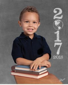 Ryker posing for his first school picture
